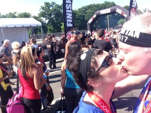 apparently kissing at the finish line is a Spartan tradition.