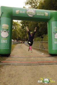Crossing the finish line; my patented victory jump